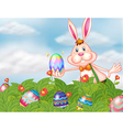 A bunny with eggs at the garden vector image vector image