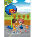 Two boys playing basketball at the basketball vector image