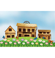 Three different wooden houses at the hill vector image vector image