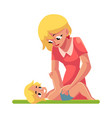 young mother changing her baby s diaper nappy vector image