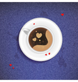 Cup of coffee on a jeans background vector image