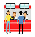 people buying tickets at counter in the cinema vector image