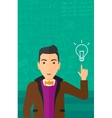 Man pointing at light bulb vector image