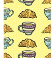 Seamless pattern with cup and croissant on vector image