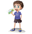 A boy holding a picture vector image vector image