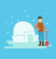 cheerful boy building a snow castle winter vector image
