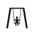 Boy swinging on a swing in the park silhouette vector image