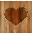 Grunge heart carved into wooden plank  EPS8 vector image