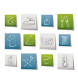 washing machine and laundry icons vector image