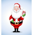 Happy cartoon Santa Claus holding a gift vector image