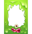 A green border template with a monsters eye and vector image vector image