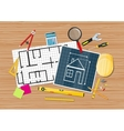Engineer desk blueprint with tools vector image