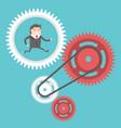 Businessman moving cog wheels vector image