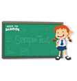 Little girl standing by the blackboard vector image