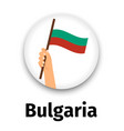 bulgaria flag in hand round icon vector image