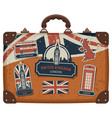 suitcase with british symbols monuments and flag vector image