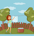 young woman hanging wet clothes after washing on vector image