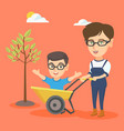 young mother pushing a wheelbarrow with her son vector image