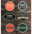 Vintage label collection on wood texture vector image