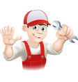 Happy plumber or mechanic with spanner vector image
