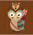tribal owl on wooden background vector image