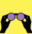 binoculars in hands vector image
