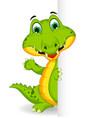 funny crocodile cartoon posing with blank sign vector image