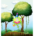 A monster playing near the tree in the forest vector image vector image