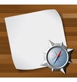 compass and paper over wooden background vector image