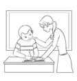 Teacher helps a boy in classroom vector image vector image