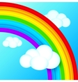 Vibrant rainbow in sky with white clouds vector image