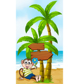 A beach with a smiling monkey sitting under the vector image