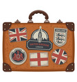 suitcase with uk and english symbols and flags vector image