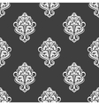 Geometric seamless pattern with floral motifs vector image