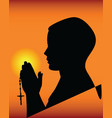 black silhouette of a praying vector image