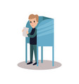 man standing in voting booth and holding ballot vector image