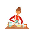 young cheerful woman mixing dough with mixer