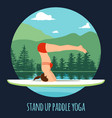 woman doing stand up paddling yoga on paddle board