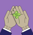 Four leaf clover on the palms vector image