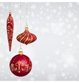 Christmas balls hanging in front of snowy vector image vector image