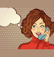 beautiful red-haired lady speaks to a retro phone vector image