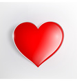 red glowing heart on a light background vector image