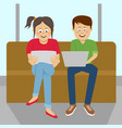 teenagers looking at their laptop and tablet vector image