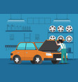 car mechanic fixing car in auto repair garage vector image