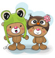 two cute cartoon bears in a frog and owl hat vector image