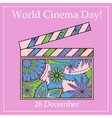World cinema day background with clapperboard vector image