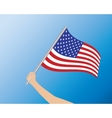 USA flag in hand vector image