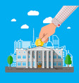 hand putting coin into bank building vector image vector image