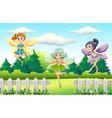 Three fairies flying in garden vector image
