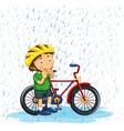 boy riding bike in rain vector image
